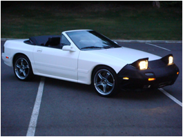 White Convertible Coupe Car with Pop-Up Headlights